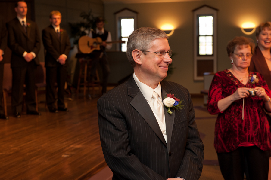 the groom's big smile as he sees his bride for the first time.