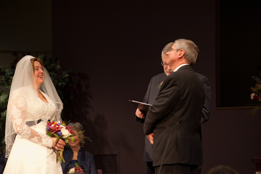 the bride and groom on stage at Walnut Hill bible Church.