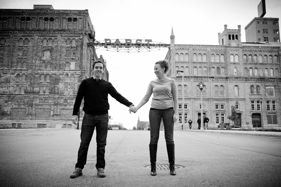 black and white shot of the couple standing in front of the Pabst brewery sign.